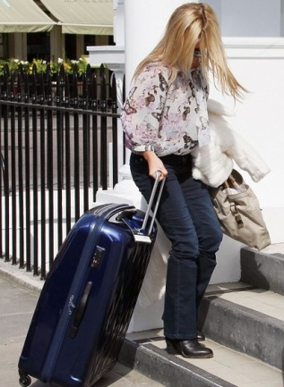 Blonde with suitcase