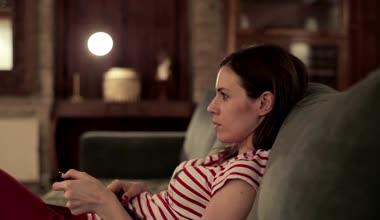 sad girl watching tv